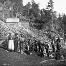 Photograph of a group at the entrance to the Crow's Nest gold mine, Nova Scotia, 1891