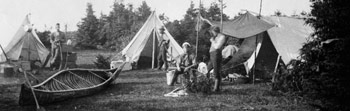 Photograph of Geological Survey camp showing geologists in front of their tents, Quebec, 1878