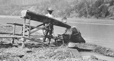 Photograph of miner washing gold, Saskatchewan River, Alberta, 1898