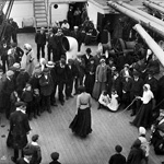 Black and white photograph of a group of people on the deck of a ship watching a woman skip rope