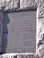 Photograph of a close-up view of an engraved stone plaque