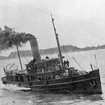 Black and white photograph of a small steamship