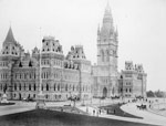 Photograph of the original Centre Block of the Parliament Buildings, featuring the Victoria Tower, completed in 1878 and destroyed by fire in 1916
