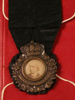 Medal bearing photo of Sir�John�A.�Macdonald, prepared for his funeral in 1891