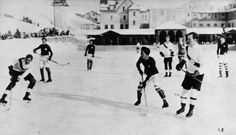 Photograph of a hockey game on an outdoor rink, 1922-1923