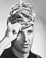 Photograph of Jacques Plante holding his face mask