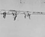 Photograph of a shinny game on Lake Couchiching, circa 1904