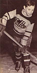 Photograph of Abby Hoffman in her hockey gear, 1955