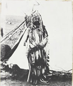 Photograph of Jerry Potts, Métis, interpreter and guide for NWMP, in garb of South Piegan Indians, 1889