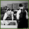 Men sort and pack finished Canadian Army uniforms in large clothing manufacturer's factory in preparation for shipping to Army headquarters