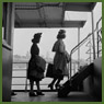 Two female Dominion Arsenals Ltd. munitions plant workers cross the river to Qu ébec by ferry