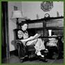 Mrs. Jack Wright relaxes with a book in her living room at the end of the day