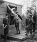 Photograph of Royal Flying Corps Canada cadets learning how to swing-start an aircraft propeller, Camp Borden, Ontario, 1917