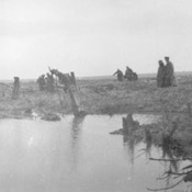 German prisoners and wounded Canadians coming through the mud, Battle of Passchendaele