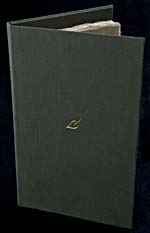 Opened dark green cloth slipcase standing upright with a small gold leaf in the centre of the front cover.