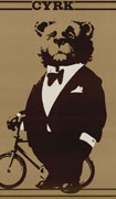 Poster with illustration of a bear wearing a black tuxedo standing next to a small bicycle, on brown background, title at top