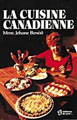 Couverture du livre de cuisine LA CUISINE CANADIENNE, sur laquelle on peut voir Madame Benoit assise à une table couverte de plats cuisinés