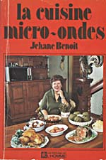 Cover of cookbook, LA CUISINE MICRO-ONDES, with a photograph of Madame Benoit seated at a table covered with food. A microwave is visible in the background