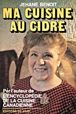Cover of cookbook, MA CUISINE AU CIDRE, with a photograph of Jehane Benoit standing in front of several barrels of cider