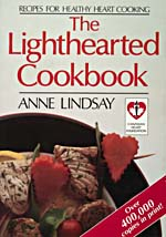 Cover of cookbook, THE LIGHTHEARTED COOKBOOK, with a photograph of a fish kebab with heart-shaped carrots