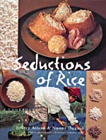 Cover of cookbook, SEDUCTIONS OF RICE: A COOKBOOK, with photographs of various rice dishes, a woman harvesting rice and samples of several varieties of rice