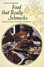Couverture du livre de cuisine FOOD THAT REALLY SCHMECKS: MENNONITE COUNTRY COOKING ornée d'un médaillon montrant une table bien garnie