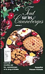 Cover of cookbook, TOUT SUR LES CANNEBERGES, black, with a strip of cranberry and a round photograph of cranberry pie, biscuits, bread, sauce and juice