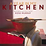 Cover of cookbook, A YEAR IN MY KITCHEN: FAVOURITE RECIPES FROM ROSE MURRAY, with a photograph of a tea towel and red bowls on a red table
