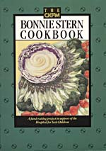 Cover of cookbook, BONNIE STERN'S ESSENTIALS OF HOME COOKING, with an illustration of an onion, purple cabbage, broccoli, carrots and other vegetables arranged in the shape of a flower