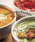 Cover of cookbook, MRS. COOK'S KITCHEN: BASICS AND BEYOND, with a photograph showing three different kinds of soup or sauces