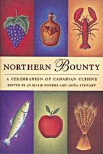 Cover of cookbook, NORTHERN BOUNTY: A CELEBRATION OF CANADIAN CUISINE, divided into six section, each containing a colourful illustration: grapes, a jug of maple syrup, a lobster, a fish, an apple and a sheaf of wheat