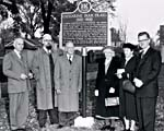 Photograph of the installation of a plaque at WESTOVE, October 1958.  Among the attendees were Anne Traill and Anne Atwood, grand-daughters of Catharine Parr Traill, and Robertson Davies