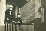 Photograph of Glenn Gould and his grandmother, standing on the porch