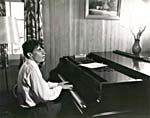 Photograph of Glenn Gould playing the piano, early 1950s