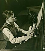 Photograph of Glenn Gould playing the organ in the concert hall of the Toronto Conservatory of Music, c. 1945
