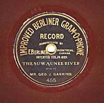 Label of a seven-inch brown disc, with gold edging and lettering, and the words IMPROVED BERLINER GRAM-O-PHONE