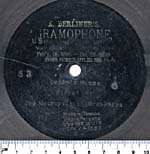 Seven-inch black disc with the HMV symbol etched in the grooves, circa 1900