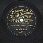 Label of a seven-inch black disc, with gold scroll lettering and foliate lines separating the words, circa 1901