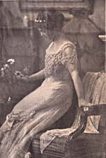 Photograph of Éva Gauthier in the gown she wore for her presentation at Buckingham Palace, 1928
