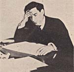 Photograph of Miro working on a new composition