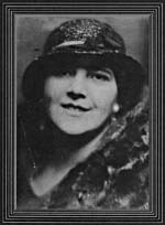 Photograph of Mary Bolduc wearing a fur coat and hat