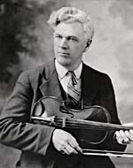 Photograph of Joseph Allard, holding a fiddle, circa 1927