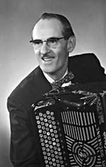 Photograph of Tommy Duchesne with accordian, date unknown