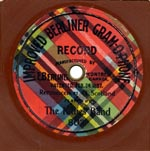 Photograph of the label on a Kilties record, showing the colourful plaid with black lettering