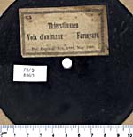 Back of a Berliner five-inch black disc recording of animal sounds, circa 1889