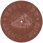 Back of a seven-inch brown disk showing the HIS MASTER'S VOICE trademark