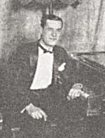 Photograph of Billy Munro, seated at the piano, circa 1923