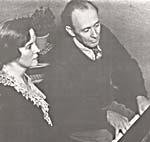 Photograph of Johana and Roy Harris seated at a piano, 1944