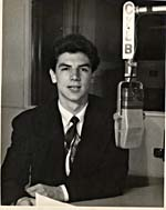 Photograph of Stan Klees in front of the microphone at CKLB radio station