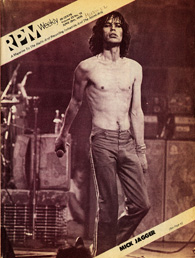 Image of a magazine cover featuring a black and white photograph of Mick Jagger on stage, holding a microphone